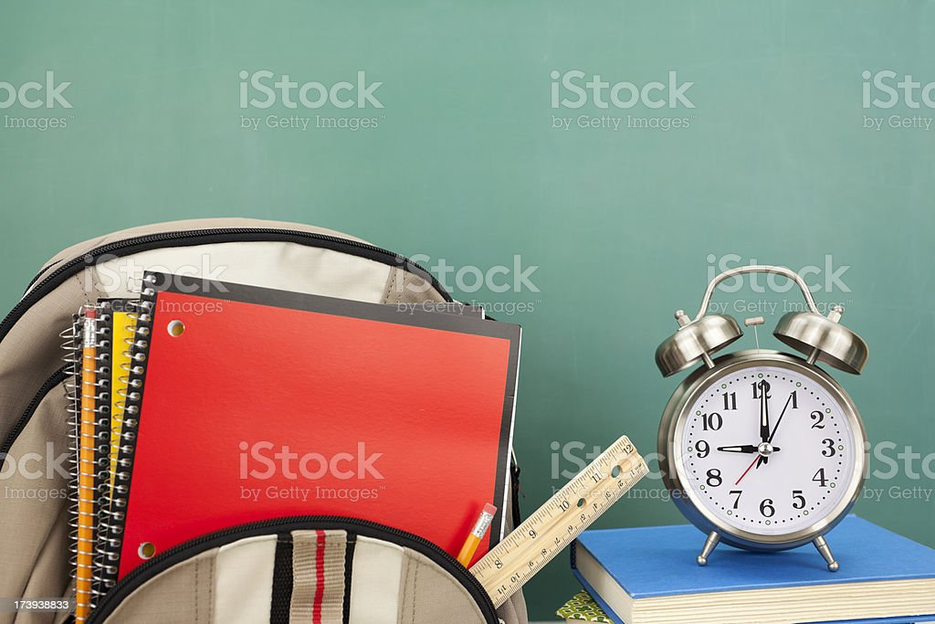 Back Pack, School Supplies, and Alarm Clock royalty-free stock photo
