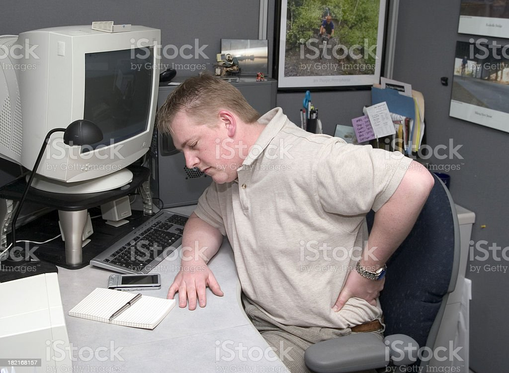 Back Pain - at work stock photo