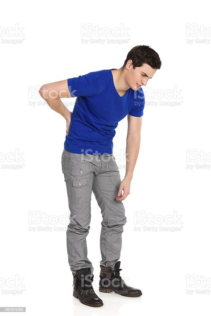 Back pain. Backache. stock photo