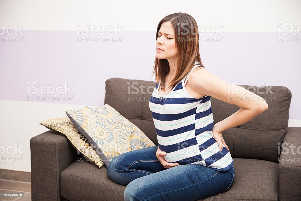 Back pain during pregnancy stock photo