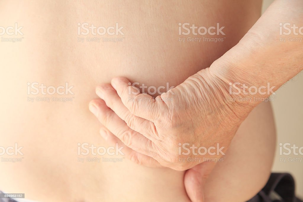 Back pain in a senior man stock photo