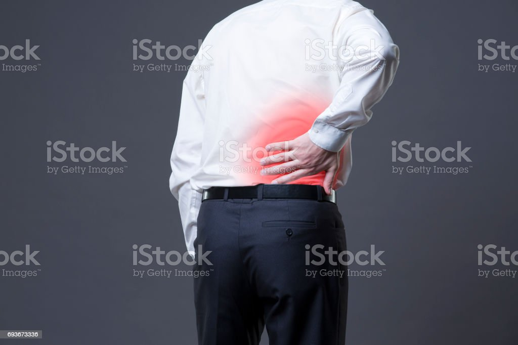 Back pain, kidney inflammation, ache in man\'s body, studio shot with...
