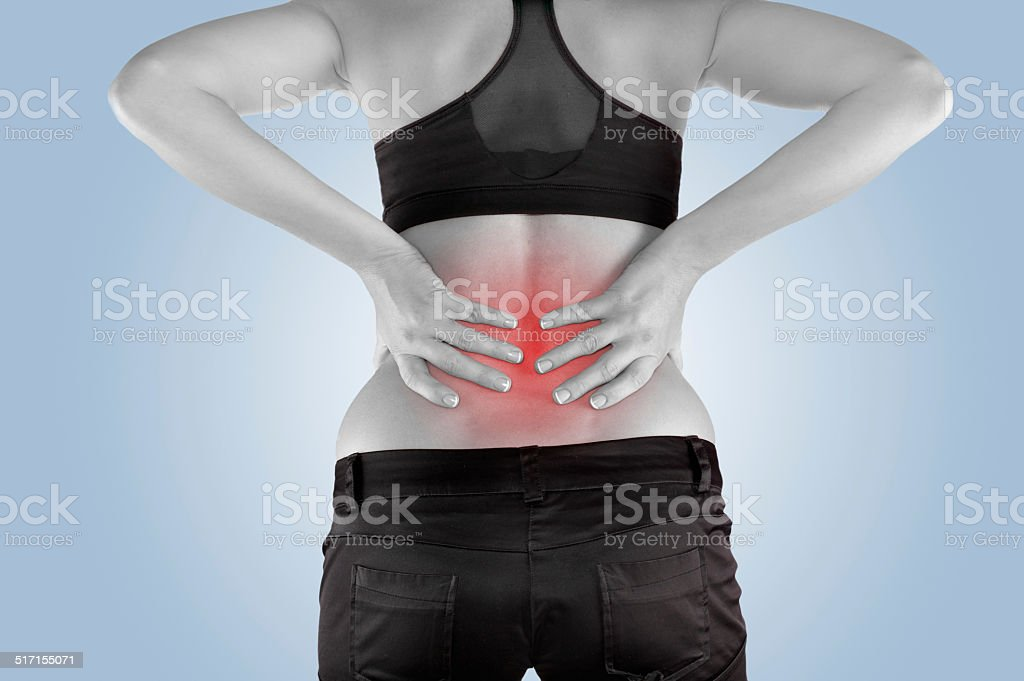 Back pain woman. stock photo