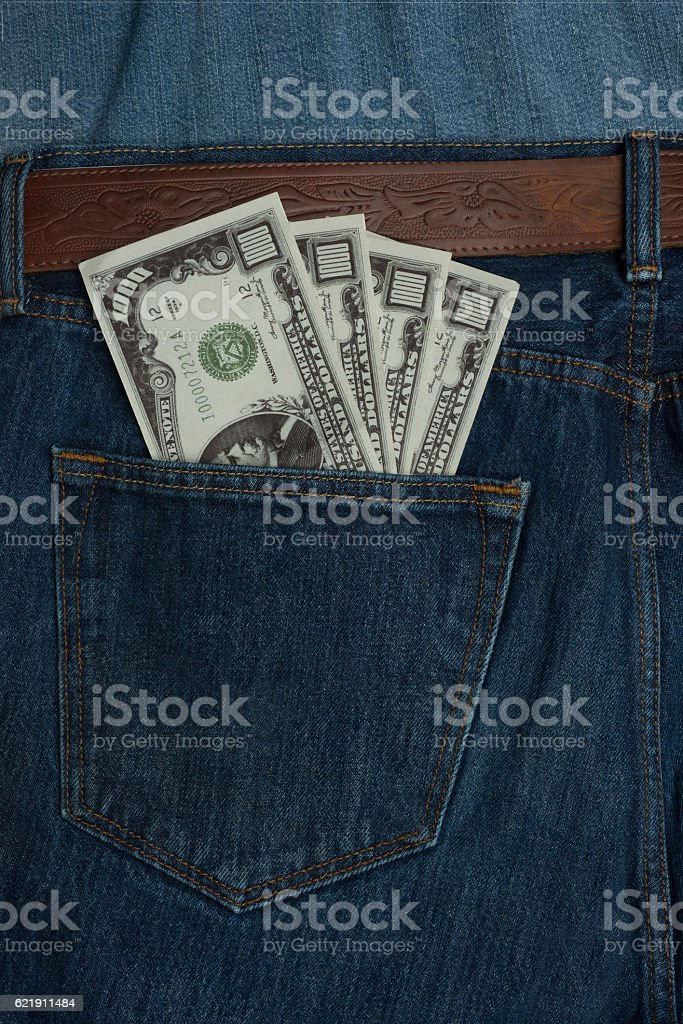 Back pocket of jeans showing 1000 dollar bills stock photo