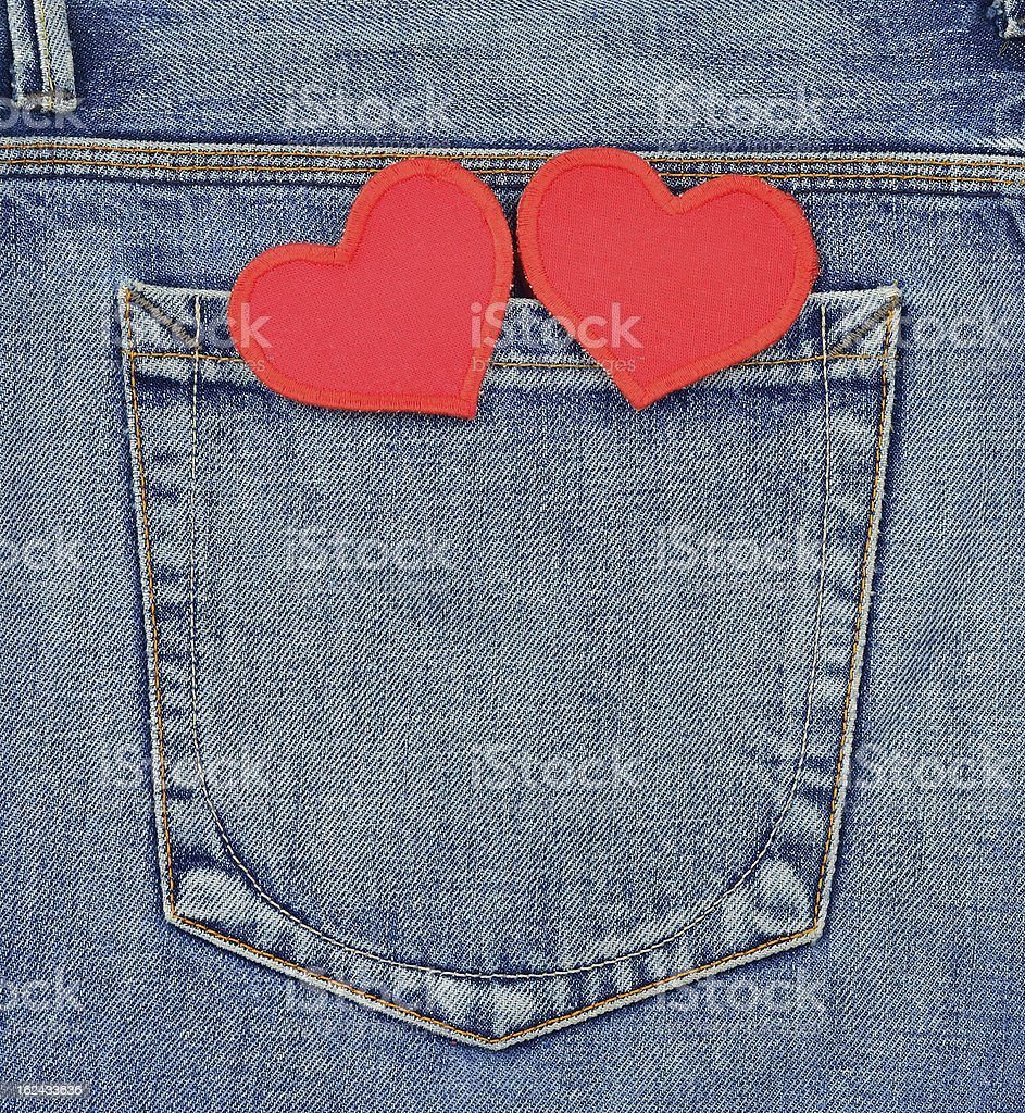 Back pocket of jeans with hearts royalty-free stock photo