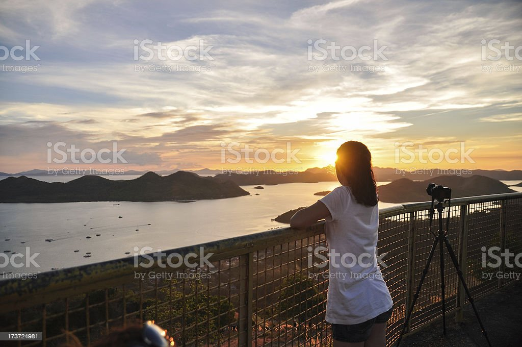 back portrait of girl looking to sunset royalty-free stock photo