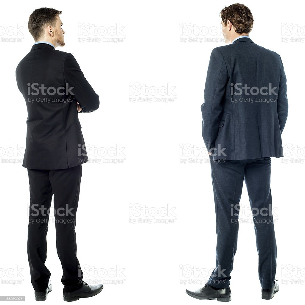 Back pose of handsome young corporates stock photo