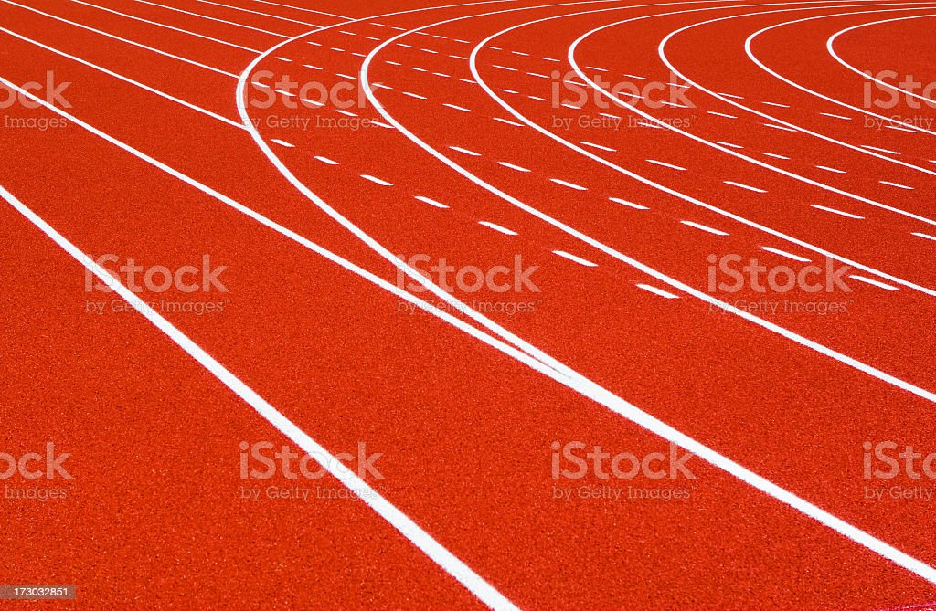 Back rounds of a red orange running track with white lines royalty-free stock photo