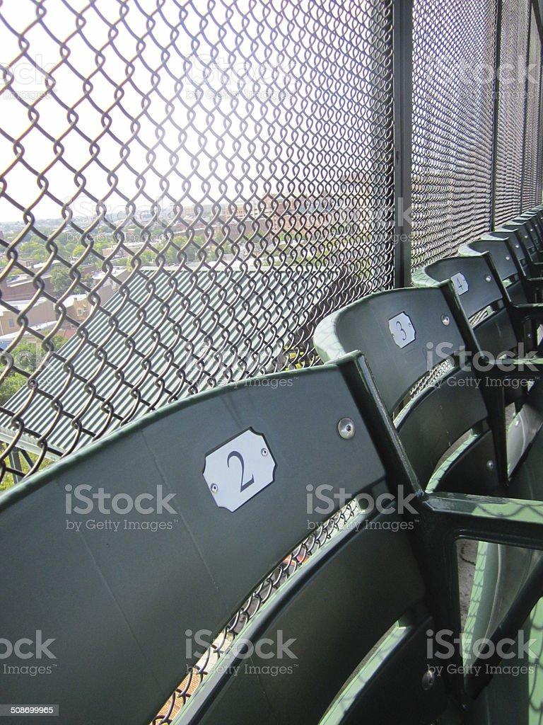 Back row of bleacher seats in ballpark stock photo