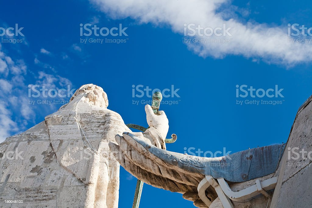 Back side of statue on St. Peter's Basilica roof stock photo