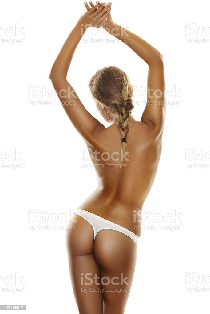 Back side view of a young, blonde woman's perfect body stock photo