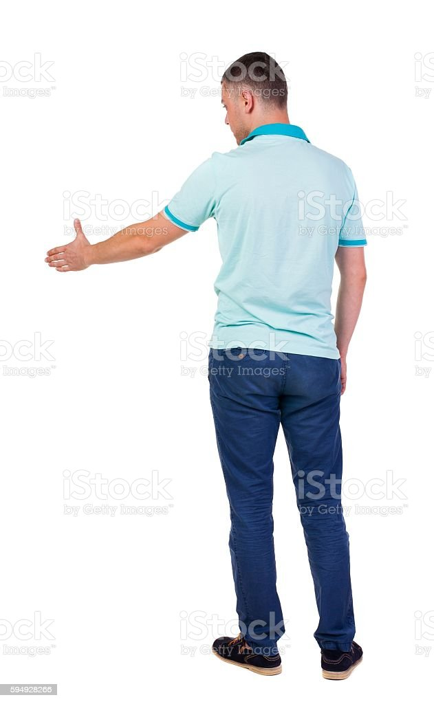 Back side view of man  in shirt handshake. stock photo