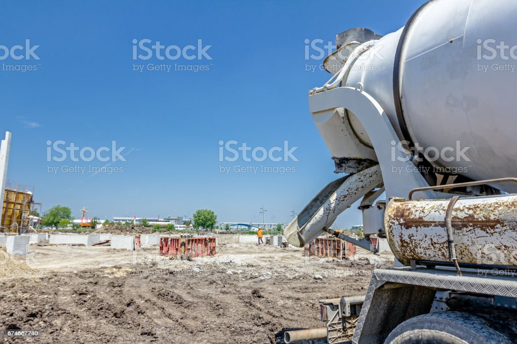 Back side view on concrete mixer, ready for pouring into transporter stock photo
