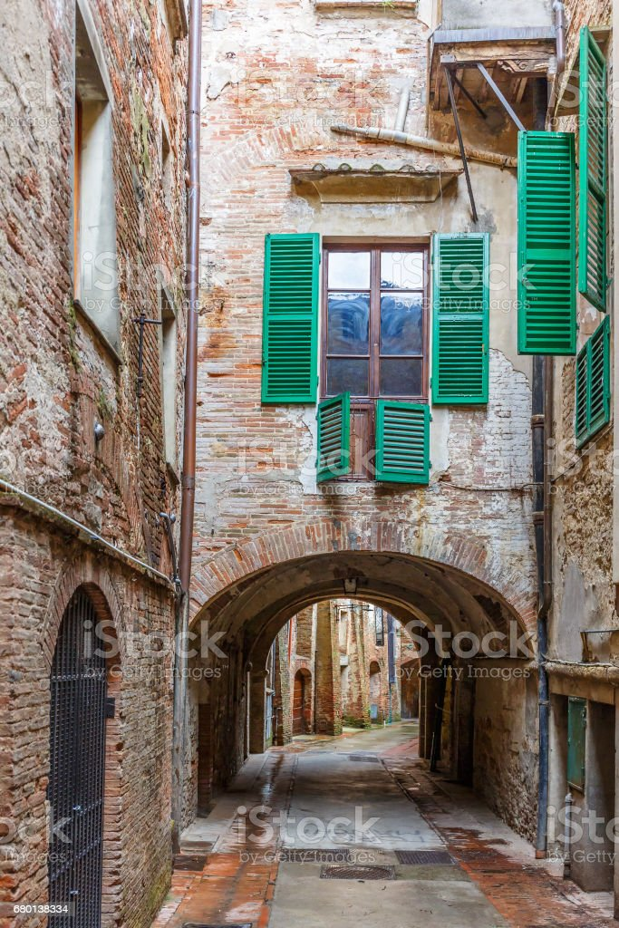 Back street with a vault in a city stock photo