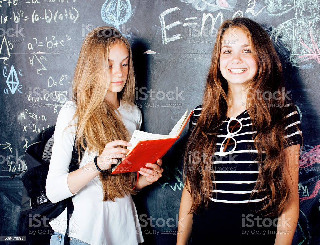 back to school after summer vacations, two teen girls in stock photo