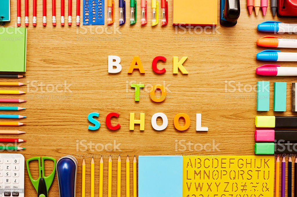 Back to school and office supplies on wooden table stock photo