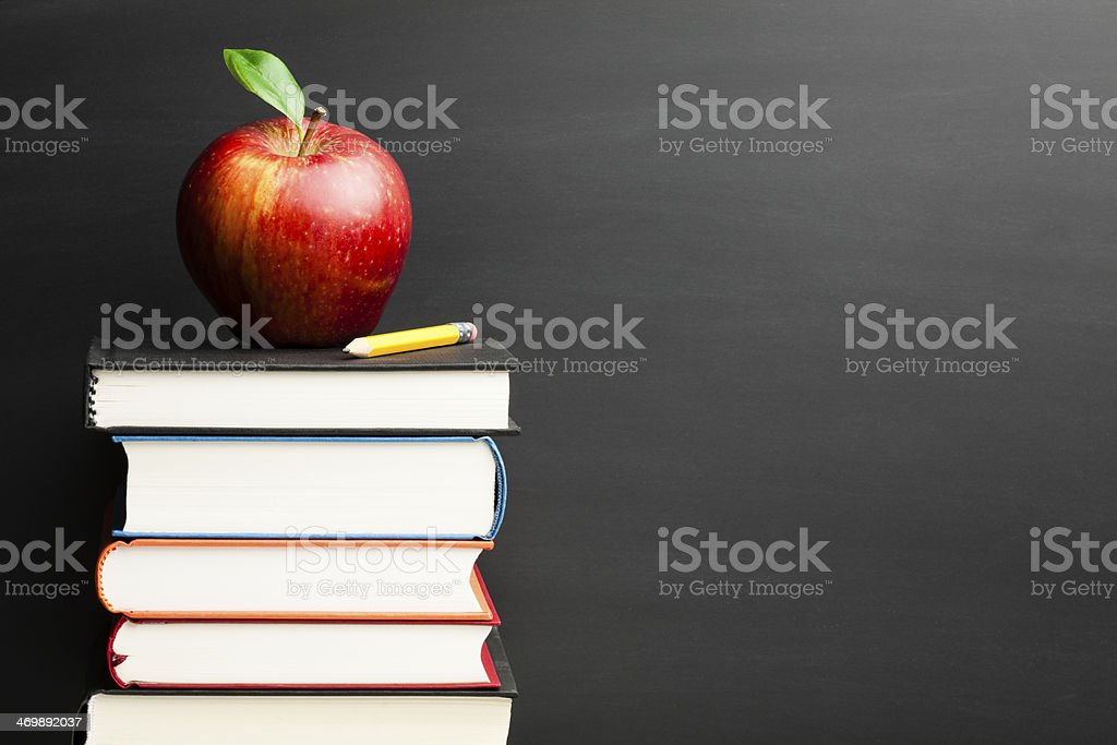 Back to School - Apple Blackboard Education Backgrounds Books Stack stock photo
