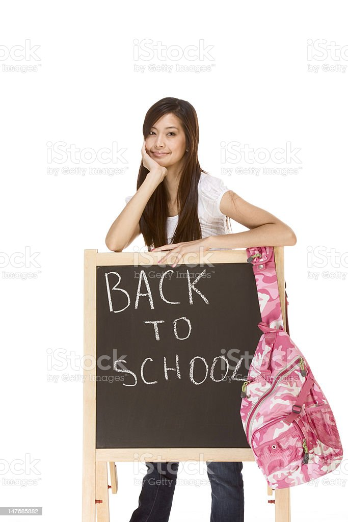 Back to school Asian female student by blackboard royalty-free stock photo