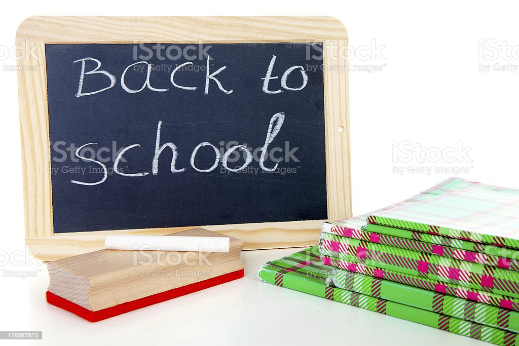 back to school: blackboard slate and stack of books royalty-free stock photo