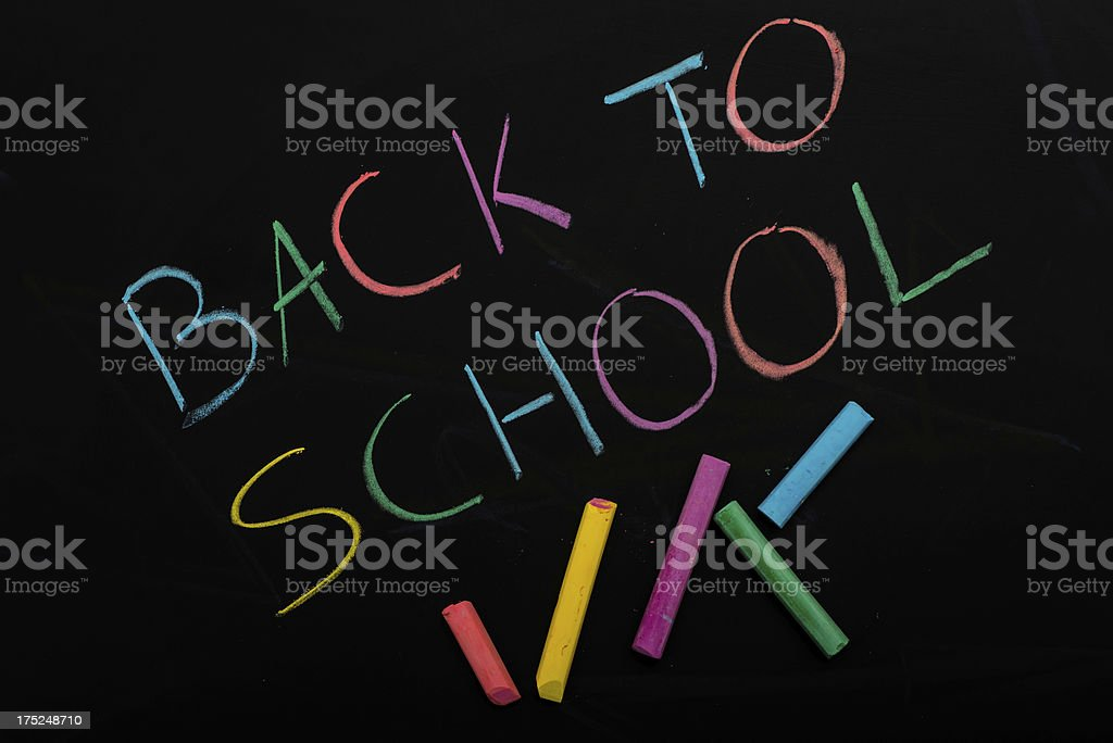 Back to school colorful written on blackboard royalty-free stock photo