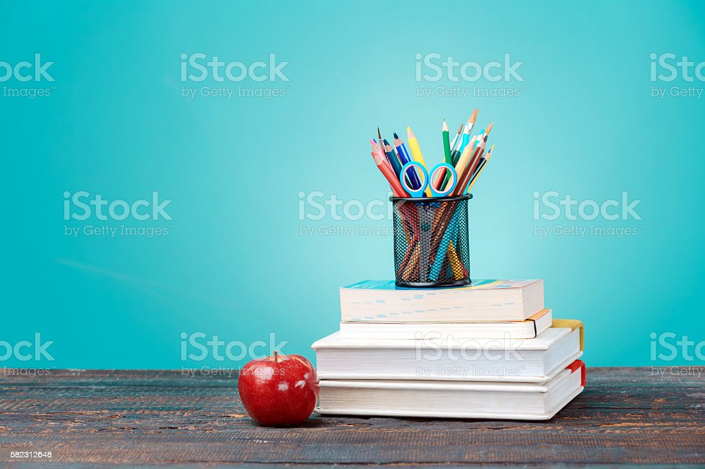Back to School concept. Books, colored pencils and apple stock photo