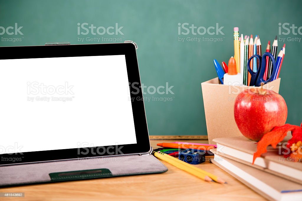 Back to school. Digital tablet, school supplies on desk. Education. stock photo