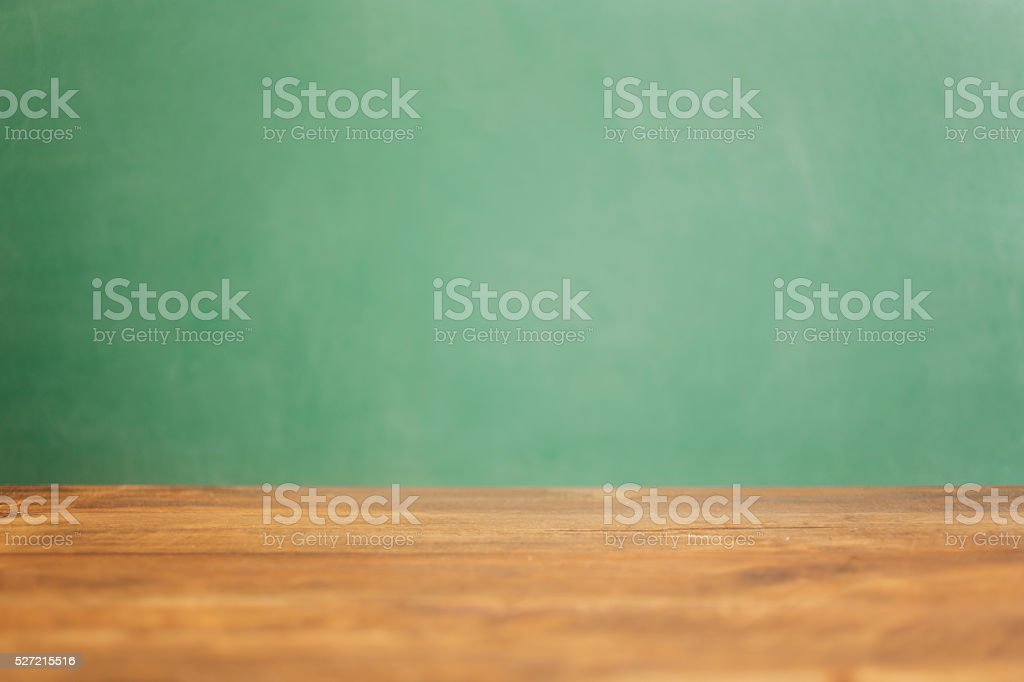 Back to school, educational background. Desk with green chalkboard. stock photo