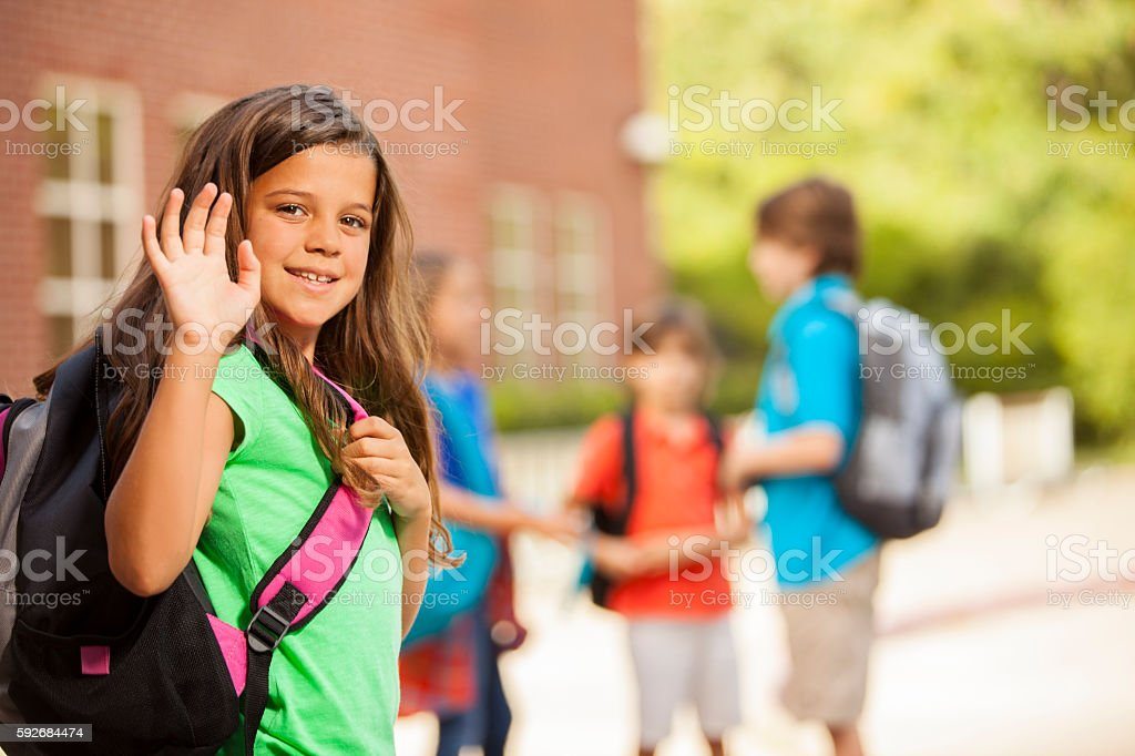 Back to School:  Elementary-age children, friends on school campus. stock photo