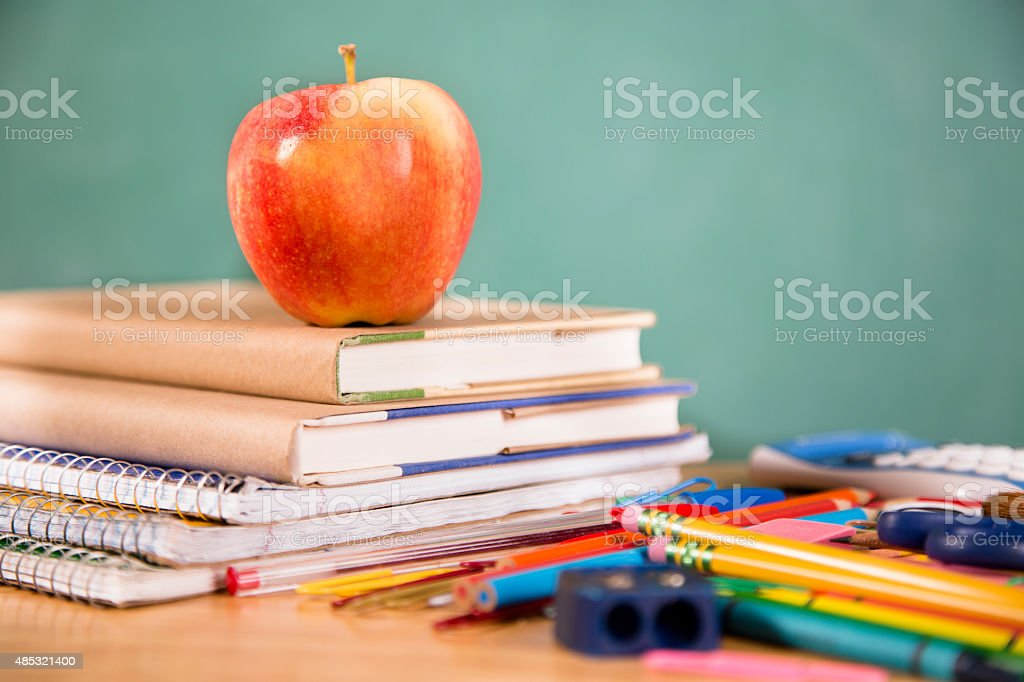 Back to school. Large pile of school supplies. Textbooks. stock photo