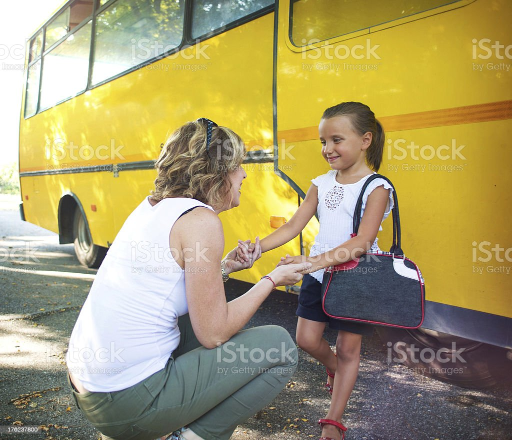 Back to School. Mother Giving Last Advice at her Daughter stock photo