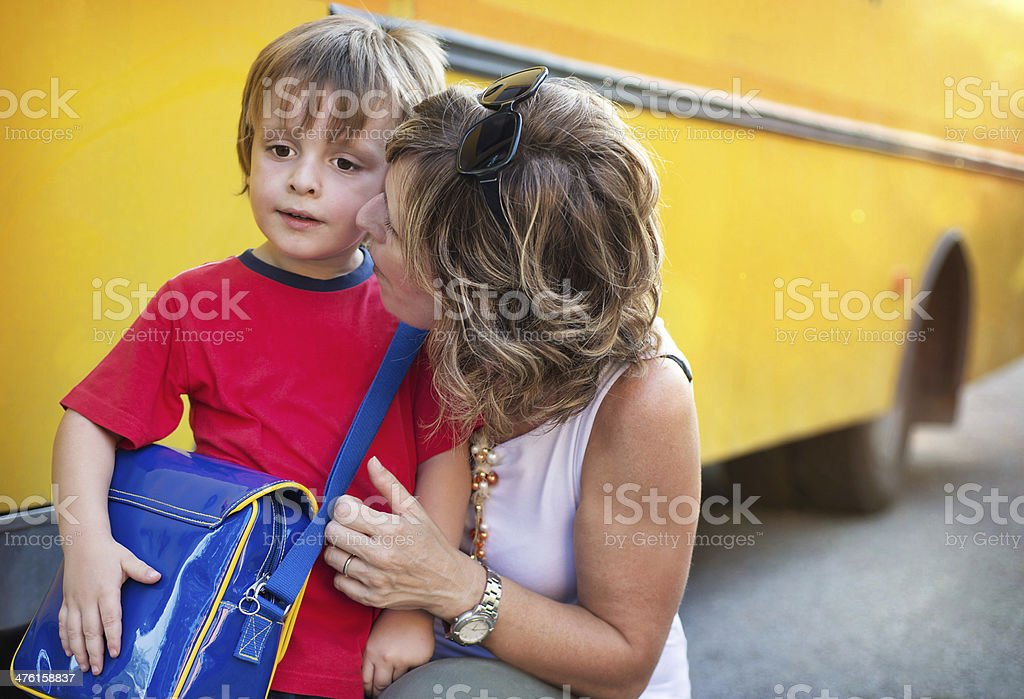 Back to School. Mother Giving Last Advice at his Son stock photo