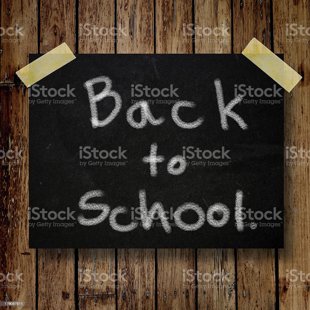 Back to school on message note with wooden background royalty-free stock photo