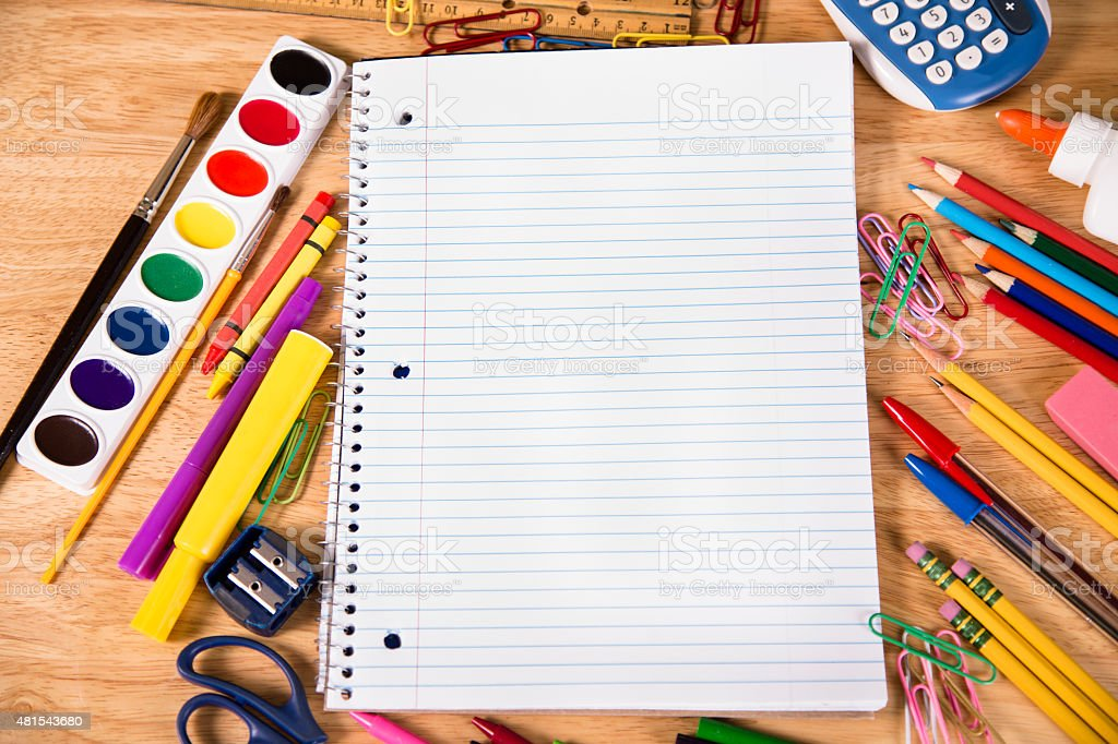 Back to school. Pile of school supplies with open notebook. stock photo