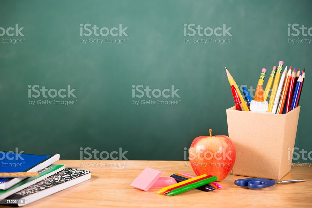 Back to school. School supplies, apple on desk. Education. stock photo