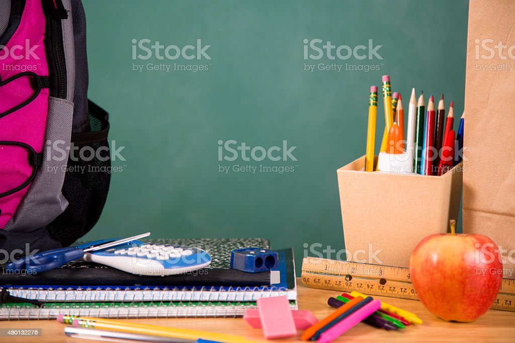 Back to school. School supplies, backpack on desk. Education. stock photo