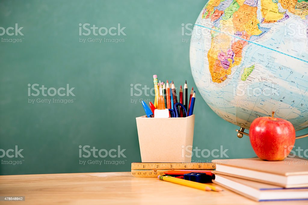 Back to school. School supplies, globe on desk. Education. stock photo