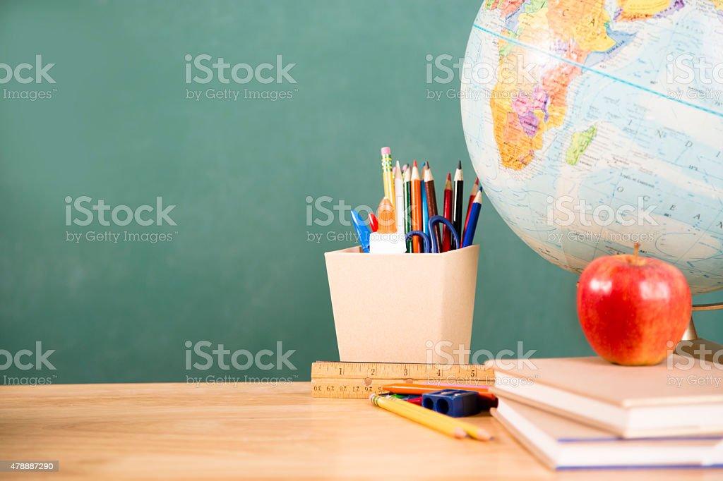 Back to school. School supplies, globe on desk. Education. stock photo