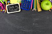 Back to School tag with school supplies border on blackboard