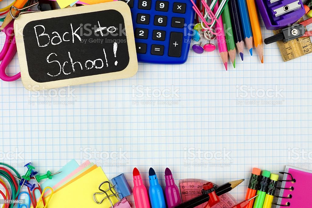 Back to School tag with school supplies on graphing paper stock photo