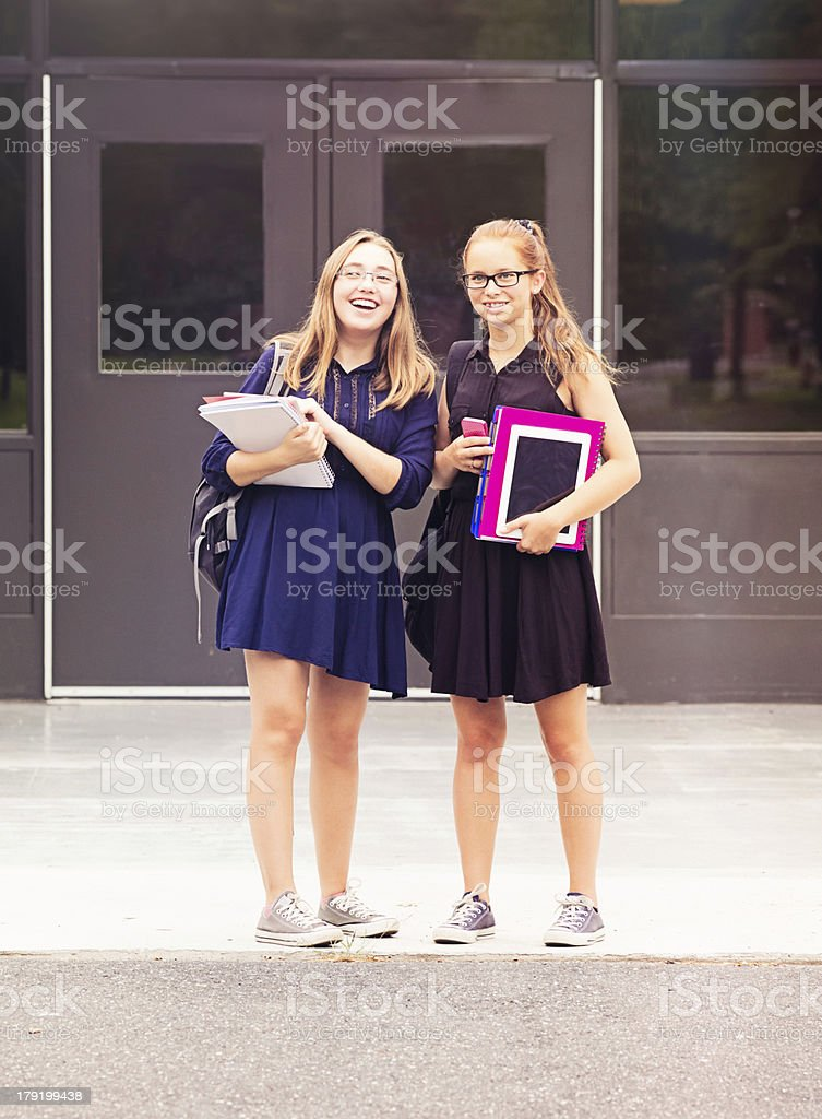 Back to school: Teenage girls waiting for their friends royalty-free stock photo