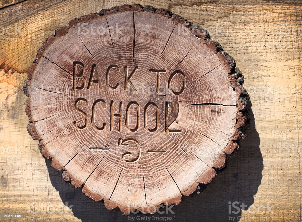 Back to school, welcome. Wood carving for your design stock photo