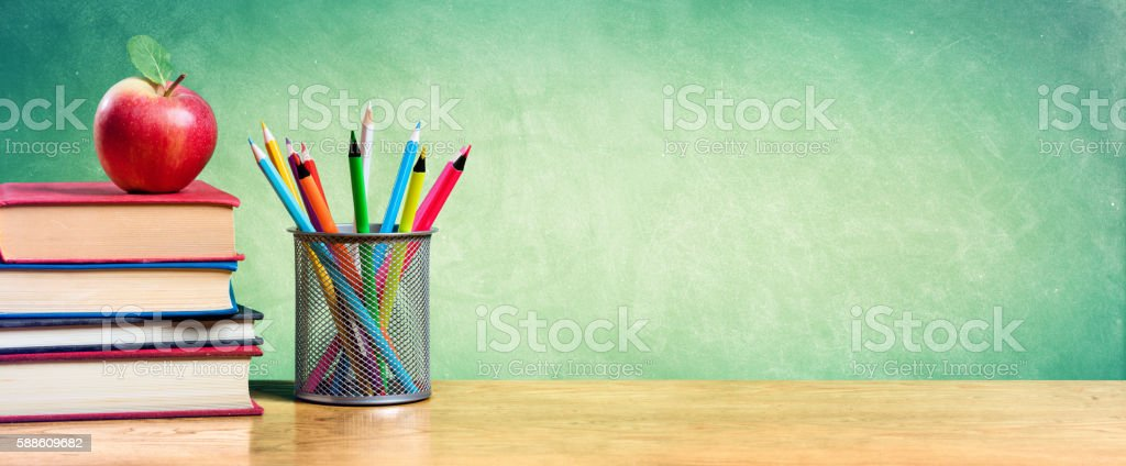 Back To School With Apple On Books And Colorful pencils stock photo