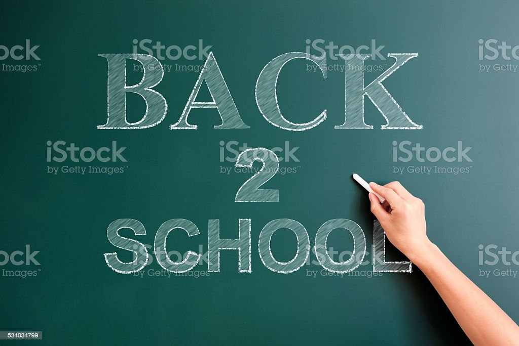 back to school written on blackboard stock photo