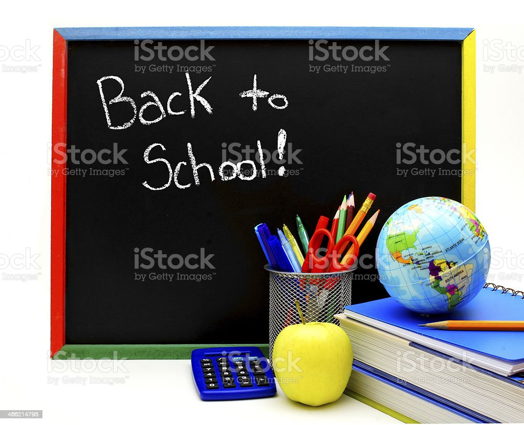 Back to School written on blackboard with school supplies royalty-free stock photo