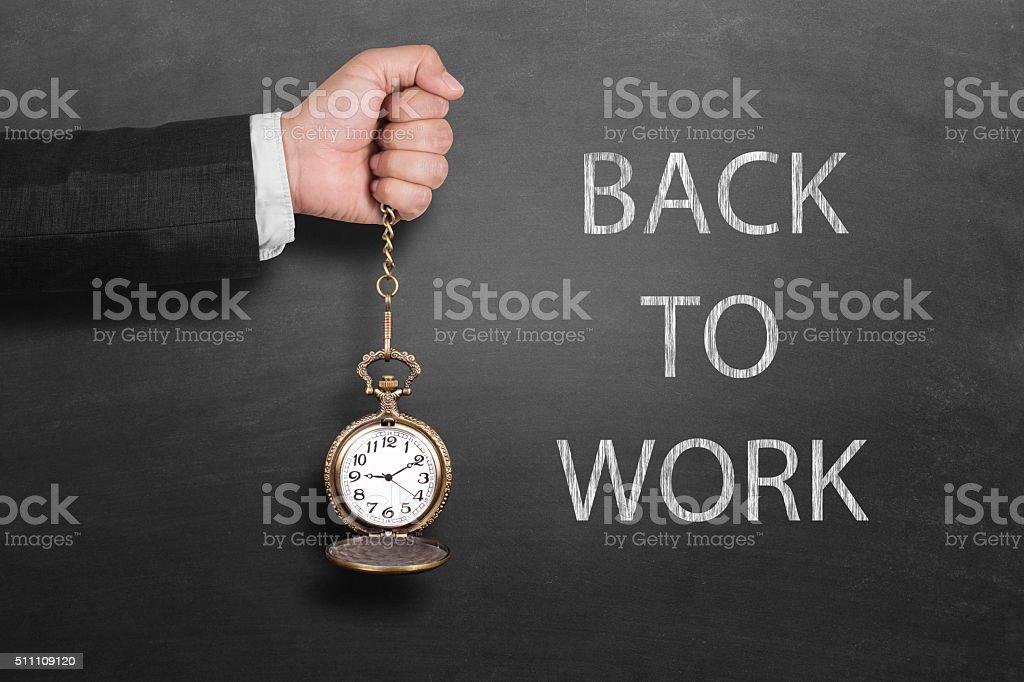 Back to work on blackboard stock photo