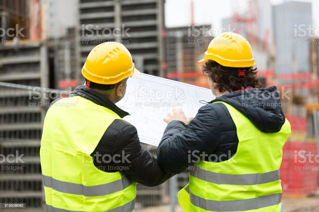 Back turned construction workers stock photo