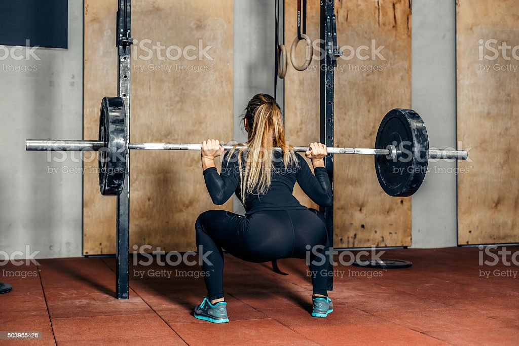 Back view attractive girl working out legs stock photo