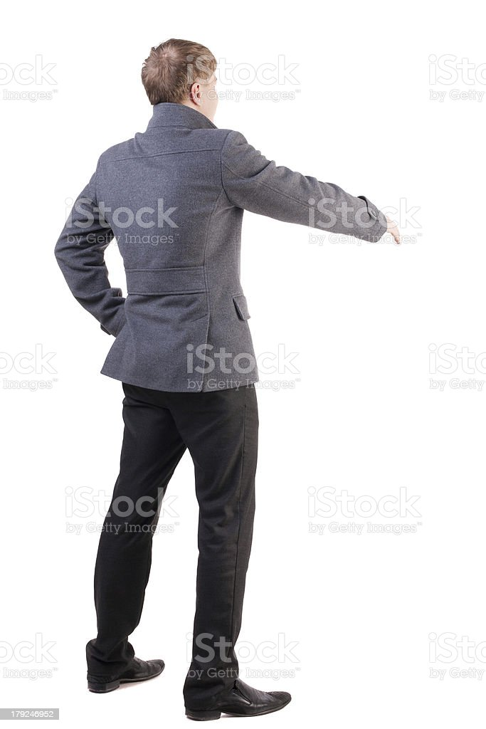 back view businessman in coat reaches out to shake hands royalty-free stock photo