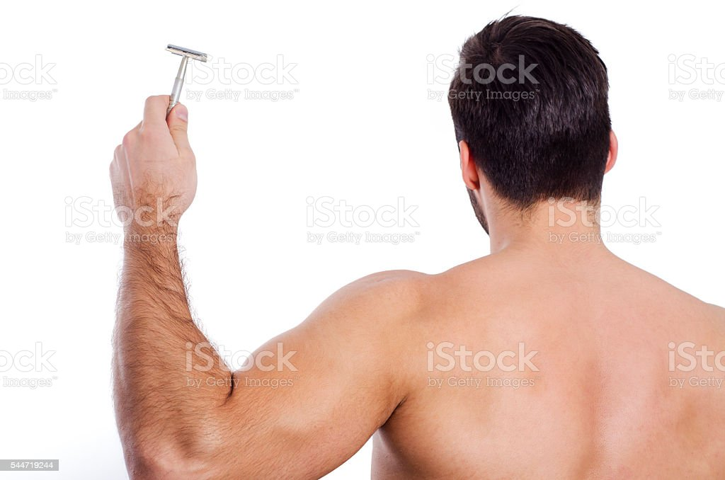 Back view, man with razor stock photo