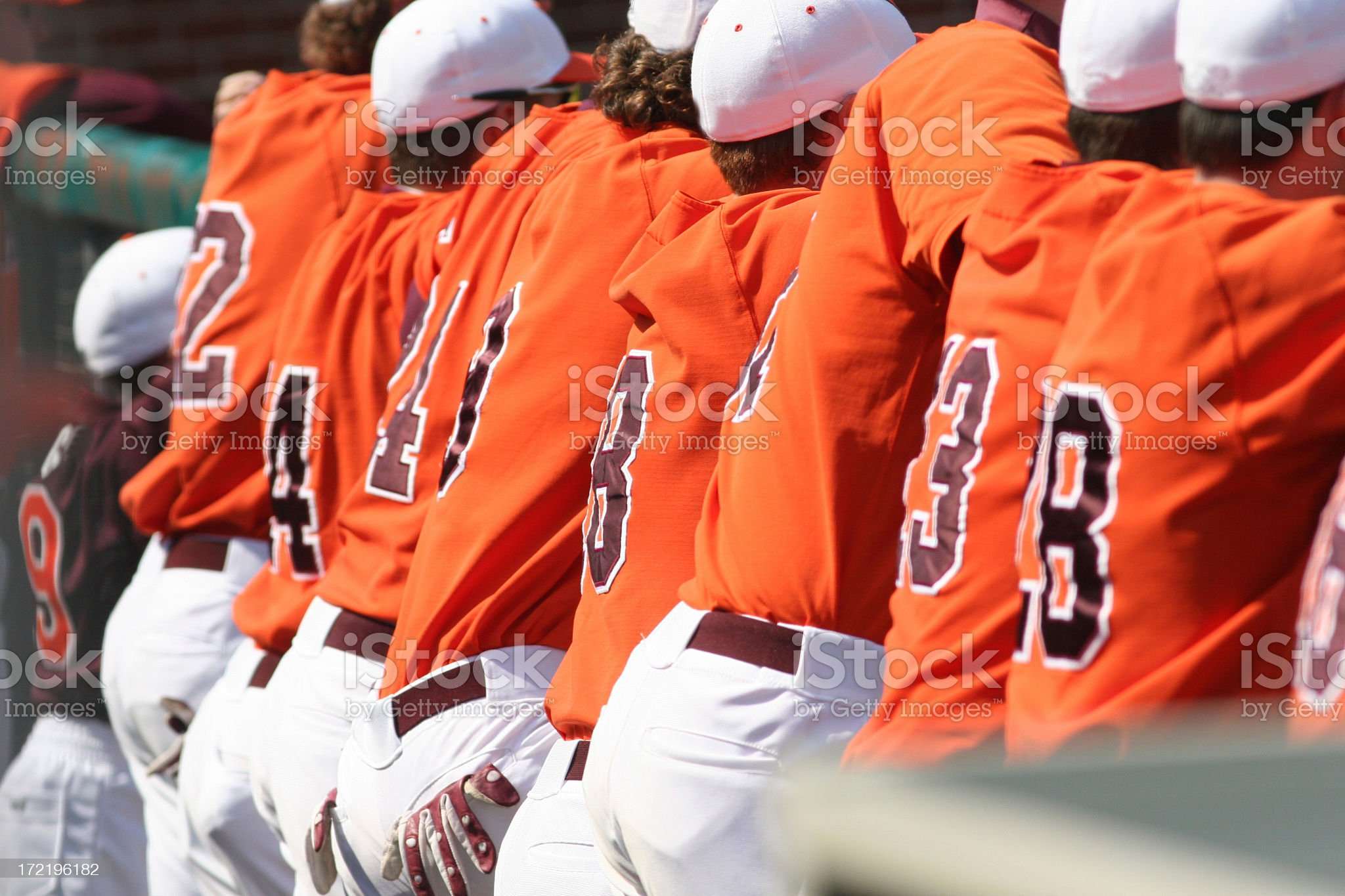 Back view of a baseball team in orange uniforms royalty-free stock photo